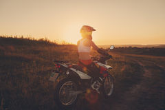 Woman biker in sunset, female motorcycle. Stock Image