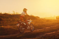 Woman biker in sunset, female motorcycle. Royalty Free Stock Photography