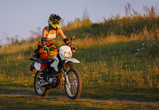Woman biker in sunset, female motorcycle. Stock Images