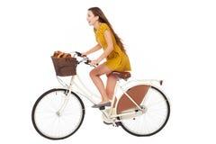Woman biking royalty free stock photography