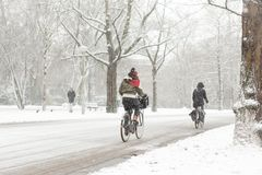 Woman biking in a snowy Amsterdam Vondelpark. Stock Photography