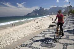 Woman biking in Ipanema Beach Rio de Janeriro Royalty Free Stock Photography