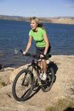 Woman biking on rock Stock Photos