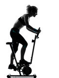 Woman biking workout fitness posture. One woman biking exercising workout fitness aerobic exercise posture on studio isolated white background Royalty Free Stock Photos