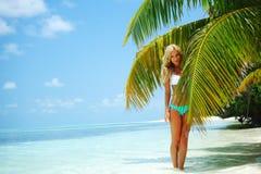 Woman in a bikini Stock Images