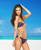 Woman in bikini with american flag Stock Photos