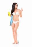 Woman in bikini applying cream Stock Photos