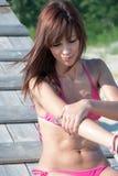 Woman in bikini applying sunblock lotion Royalty Free Stock Images