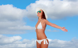 Woman in bikini with arms outstretched Royalty Free Stock Photography