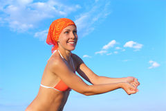 Woman in bikini and bandana playing volleyball Royalty Free Stock Photography