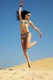 Woman in bikini on beach Royalty Free Stock Image