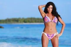 Woman in bikini on beach Stock Photography