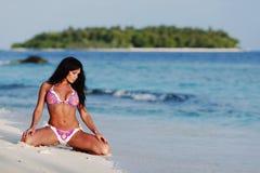 Woman in bikini on beach Royalty Free Stock Photo