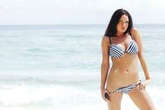 Woman in bikini on beach. Beautiful woman in bikini posing on beach Stock Images