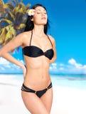 Woman in bikini at beach Royalty Free Stock Photos