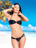 Woman in bikini at beach Royalty Free Stock Images