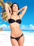 Woman in bikini at beach Stock Photo