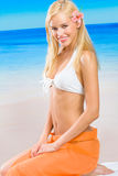 Woman in bikini on beach Stock Image