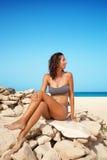 Woman in bikini on a beach Royalty Free Stock Photo