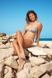 Woman in bikini on a beach Stock Image