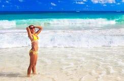 Woman in bikini on the beach. Royalty Free Stock Image