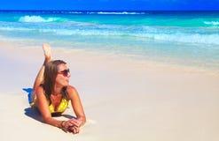 Woman in bikini on the beach. Stock Photography