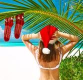 Woman in bikini on a beach at christmas. Woman in bikini on a tropical beach at christmas Stock Photo