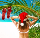 Woman in bikini on a beach at christmas Stock Photo