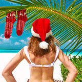 Woman in bikini on a beach at christmas Royalty Free Stock Image