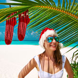 Woman in bikini on a beach at christmas. Woman in bikini on a tropical beach at christmas Royalty Free Stock Photos