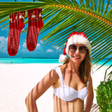 Woman in bikini on a beach at christmas Stock Photos