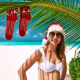 Woman in bikini on a beach at christmas. Woman in bikini on a tropical beach at christmas Stock Photos