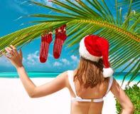 Woman in bikini on a beach at christmas. Woman in bikini on a tropical beach at christmas Royalty Free Stock Image