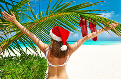 Woman in bikini on a beach at christmas Royalty Free Stock Photos