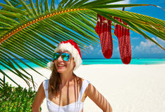 Woman in bikini on a beach at christmas Royalty Free Stock Photography