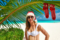 Woman in bikini on a beach at christmas Royalty Free Stock Images