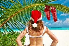 Woman in bikini on a beach at christmas. Woman in bikini on a tropical beach at christmas Royalty Free Stock Photo