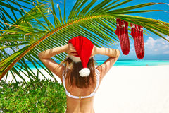 Woman in bikini on a beach at christmas Stock Photos