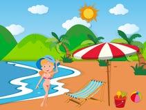 Woman in bikini on the beach Stock Photography