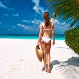 Woman in bikini on a beach at Maldives Stock Photos