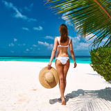 Woman in bikini on a beach at Maldives Royalty Free Stock Photo