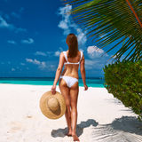 Woman in bikini on a beach at Maldives Stock Photography