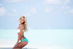 Woman in bikini on beach Royalty Free Stock Images