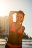 A woman in bikini at the beach Stock Photography