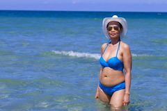 Woman with bikini blue body sexy on blue water at beach. Ban Krut Beach, in Prachap Kirikhun Province Thailand is famous for travel royalty free stock photos