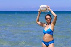 Woman  with bikini blue body sexy on blue water. Woman with bikini blue body sexy on blue water at beach Ban Krut Beach, in Prachap Kirikhun Province Thailand is royalty free stock image