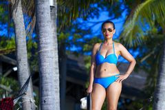 Woman with bikini blue show shape sexy. Morning at the beach Ban Krut Beach, in Prachap Kirikhun Province Thailand is famous for travel royalty free stock photo