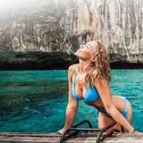 Woman in bikini on boat. Floating in beautiful lagoon in Thailand Royalty Free Stock Image