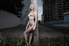 Woman in a bikini by a building Stock Image
