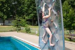 Woman in Bikini on climbing wall Stock Photos